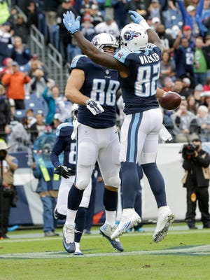 Tennessee Titans tight end Craig Stevens (88) celebrates with tight end Delanie Walker (82) after Stevens scored a touchdown on a 20-yard pass play against the Raiders on Nov. 29.