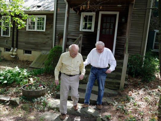 Norman MacArthur, left, helps his partner Bill Novak