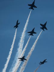 The U.S. Navy Blue Angels take to the skies for the