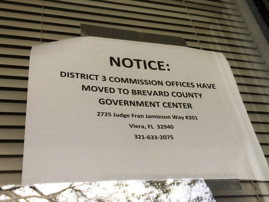 A sign on the door of the former District 3 County Commission office in Melbourne indicates the office has moved to Viera.