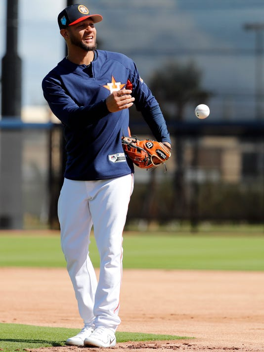 Houston Astros infielder Yuli Gurriel tosses a ball during spring training baseball practice Monday, Feb. 19, 2018, in West Palm Beach, Fla. (AP Photo/Jeff Roberson)
