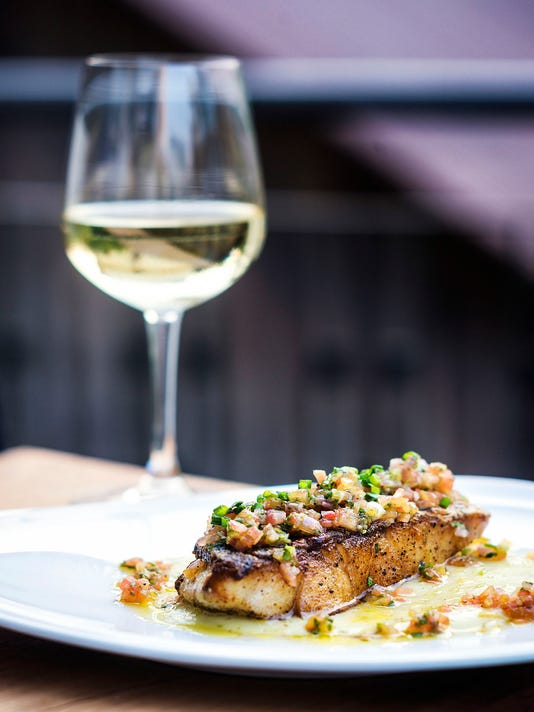 sea bass fish with mexican salsa sauce