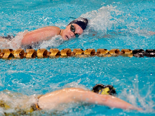 New Oxford's Ashley Myers, top, swims the final lap