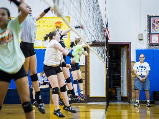 Steve Shondell and Don Shondell coach Burris Middle School's volleyball team during practice Tuesday afternoon.