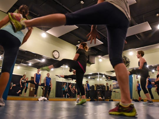 Cardio dance class members work out Wednesday, March