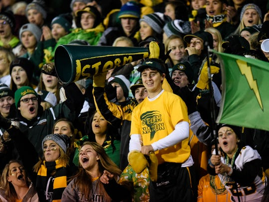 Sauk Rapids fans in the student section cheer following