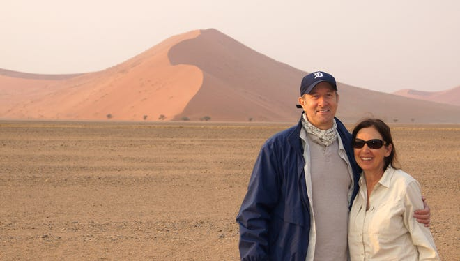 Jerry and Dale Rubin from Royal Oak took the D to Namib Desert in theÊNamib-Naukluft National ParkÊofÊNamibia in Sept. 2015. The dune with the lighting on it looks like the mitten of Michigan.