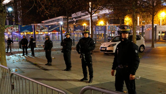 Police officers secure the  Stade de France stadium during the international friendly soccer France against Germany in Saint Denis, outside Paris.