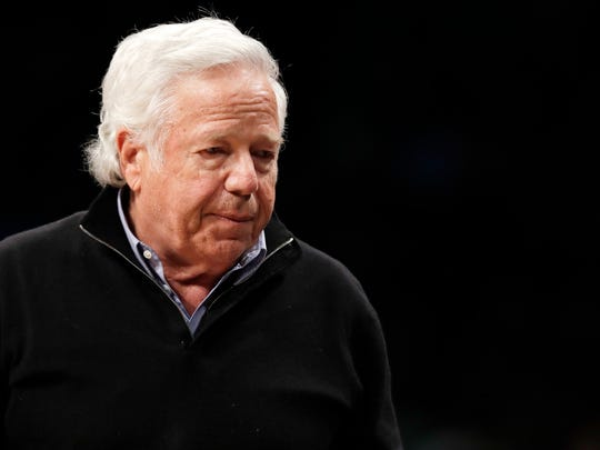 FILE - In this April 10, 2019, file photo, New England Patriots owner Robert Kraft leaves his seat during an NBA basketball game between the Brooklyn Nets and the Miami Heat, in New York. Attorneys for Kraft will be in court asking a judge to throw out a video that police say shows him paying for sex at a Florida massage parlor. (AP Photo/Kathy Willens, File)