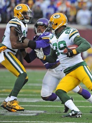 Green Bay Packers wide receiver James Jones (89) catches a pass and looks to run as Green Bay Packers wide receiver Randall Cobb (18) blocks downfield at TCF Bank Stadium in Minneapolis.