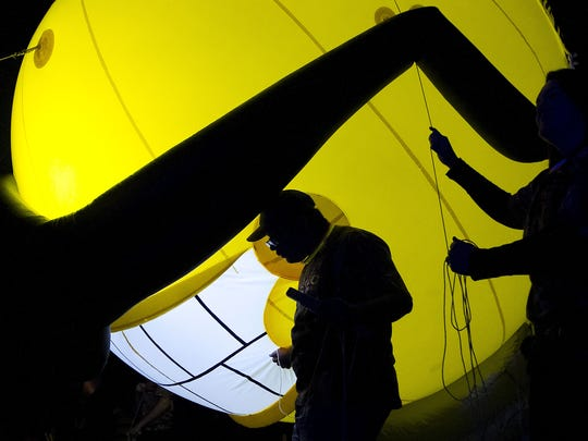 Handlers of the LCEC balloon avoid powerlines during the Edison Festival of Light Grand Parade in February.
