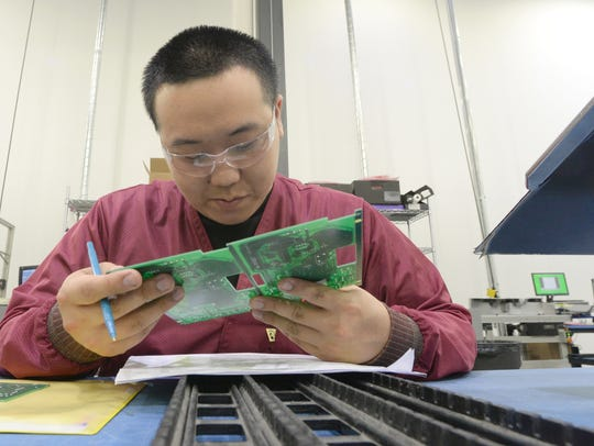 Michael Yang inspects circuit boards at Kenall Manufacturing  April 20, 2017. The company makes a variety of LED lighting products at their facility at 10200 55th St., Kenosha.