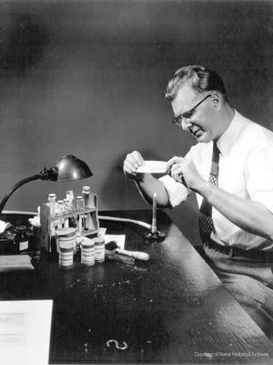 Chester Carlson works on his xerographic process.