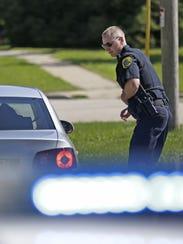 Green Bay police officer Tom Herber talks with a motorist