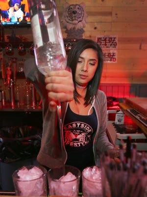 Legendary Tipsy Tiger bartender Jayni Rodriguez prepares drinks for customers at the popular East Side bar.