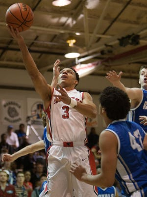 Park Tudor's Bryce Moore goes to the hoop against Hamilton Southeastern at Park Tudor, Dec. 22, 2014. Park Tudor won 48-38.