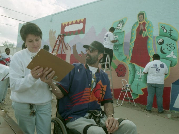 Neal Walk talks with Mary Varela at the Downtown Learning