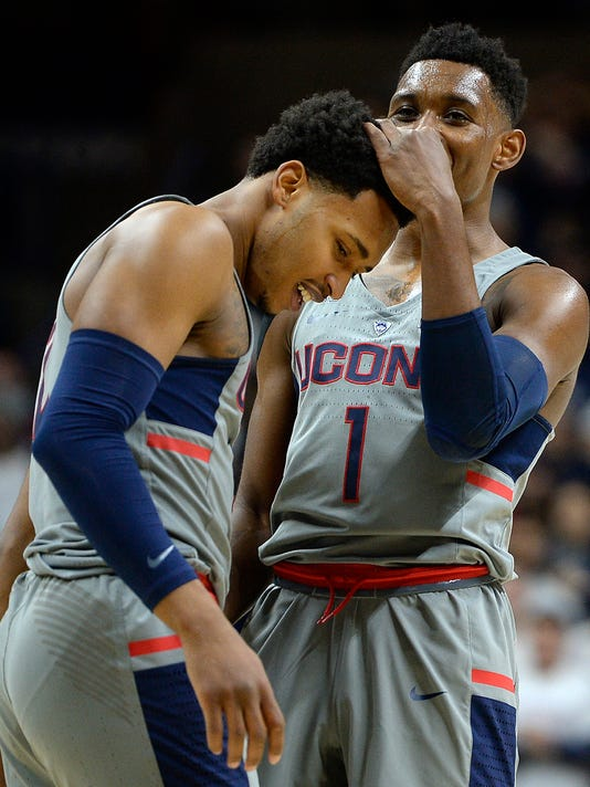 Connecticut's Christian Vital, right, celebrates with Jalen Adams during the second half of the team's NCAA college basketball game against South Florida, Wednesday, Feb. 8, 2017, in Storrs, Conn. (AP Photo/Jessica Hill)