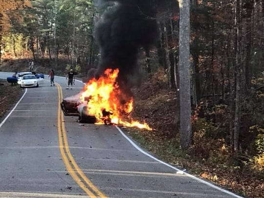 "A car burns on a stretch of U.S. Highway 129 known as ""The Dragon"" on Sunday, Nov. 5, 2017."