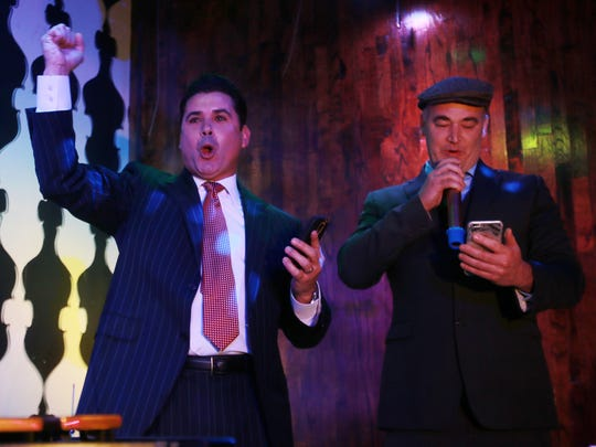 Ysleta Independent School District Superintendent Xavier De La Torre, left, lets out a yell after school board Trustee Shane Haggerty announced results from early voting on the $430.5 million bond issue in November 2015 at the Coco Miel Restaurant and Coco Bar.