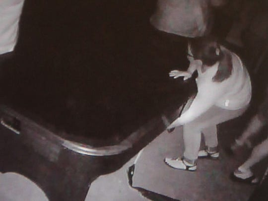 A Disaster Room 915 participant searches for clues in the dark. The image was taken from an overhead camera in the room.