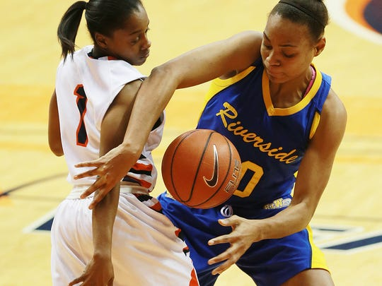 UTEP's Starr Breedlove and University of California, Riverside's Réjane Verin scramble for a loose ball during the second quarter Friday.