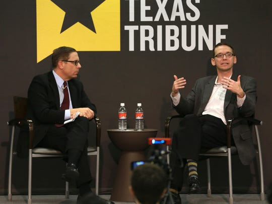 New Texas Education Commissioner David Morath, right,