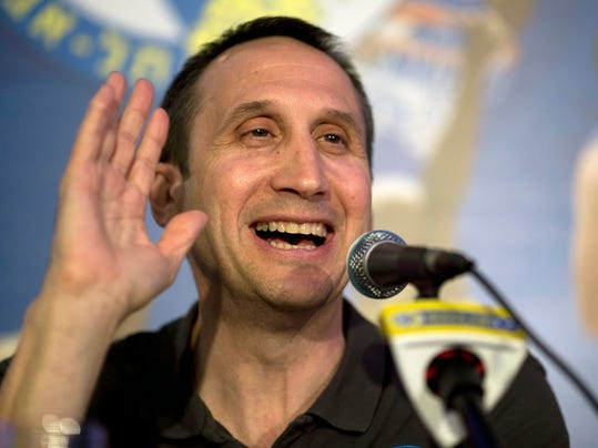 """Maccabi Tel Aviv's head coach David Blatt speaks in a news conference in Tel Aviv, Israel,Thursday, June 12, 2014. David Blatt has stepped down as coach of European club champion Maccabi Tel Aviv to pursue a job in the NBA. Blatt told a news conference on Thursday he wanted to fulfil his """"dream"""" of coaching in the NBA. He says he is weighing offers from unnamed teams. The Cleveland Cavaliers, Minnesota Timberwolves and Golden State Warriors are all believed to be interested. Blatt, who grew up near Boston and played college ball at Princeton, has had a successful career coaching overseas. Last month, he led Maccabi to an upset win over Real Madrid in the European basketball championship. At a championship celebration, Prime Minister Benjamin Netanyahu playfully told Blatt not to leave. (AP Photo/Ariel Schalit)"""
