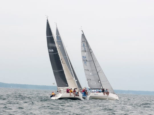 A trio of boats including Venon sets out for Mackinac