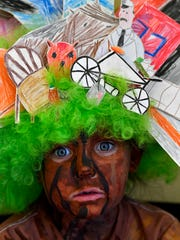 "Elliott Rose Delaney, 6 and visiting from Chattanooga, Tennessee, won first place in the age 5-8 category in the Oliver Jeffers Character Costume Contest as the tree from ""Stuck"" at last years Children's Art & Literacy Festival downtown."