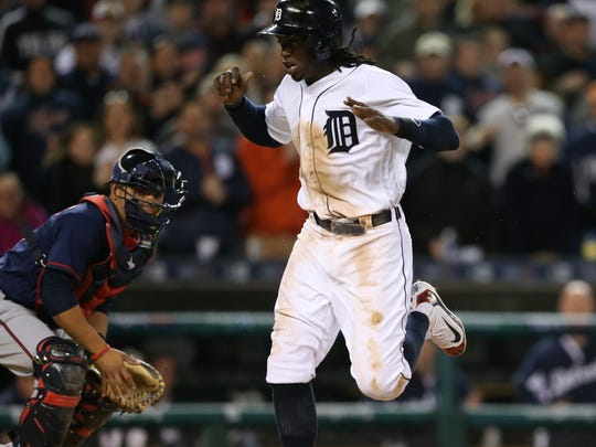 Tigers centerfielder Cameron Maybin scores during the seventh inning of the Tigers' 7-2 win over the Twins Tuesday at Comerica Park.