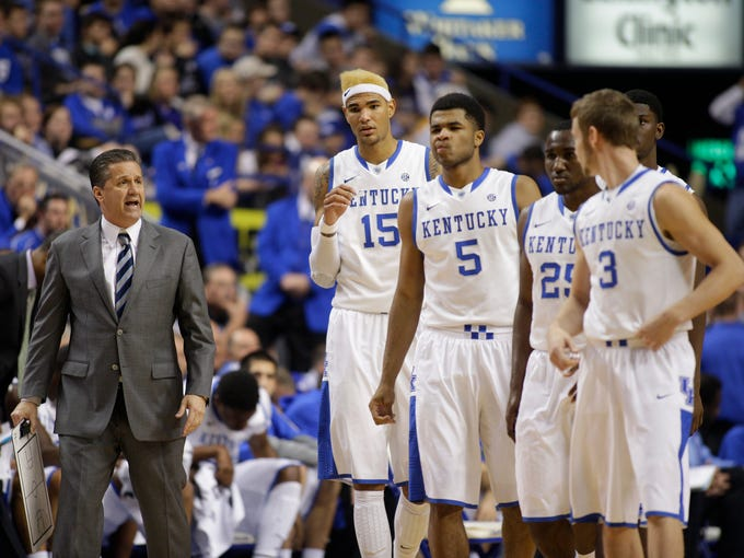 UK head coach John Calipari, left, talks with his team coming out of a timeout. The University of Kentucky hosted Boise State, Tuesday, Dec. 10, 2013 at Rupp Arena in Lexington. Photo by Jonathan Palmer/Special to the Courier-Journal