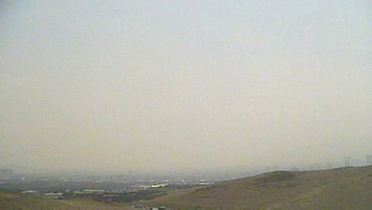 Smoke blankets Reno on Friday, July 20, 2018. This shot is facing downtown Reno, Mt. Rose and Slide Mountain. Image is from the Western Regional Climate Center webcam at the Desert Research Institute.