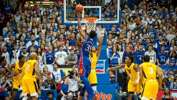 Kansas makes a case for a No. 1 NCAA tourney seed in sinking West Virginia