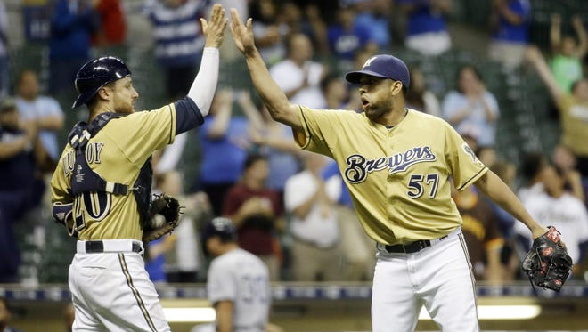 Milwaukee Brewers catcher Jonathan Lucroy and relief pitcher Francisco Rodriguez celebrate after a baseball game against the San Diego Padres Wednesday in Milwaukee.
