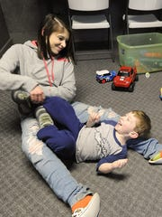 Cassie Sayre plays with son Xander, 3, at the Jericho House on Wednesday.