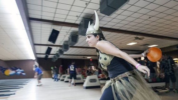Jessica Knecht bowls while in full costume during the 13th Annual Lebowski Fest Bowling Party on Saturday night at Executive Strike on Phillips Lane. July 12, 2014