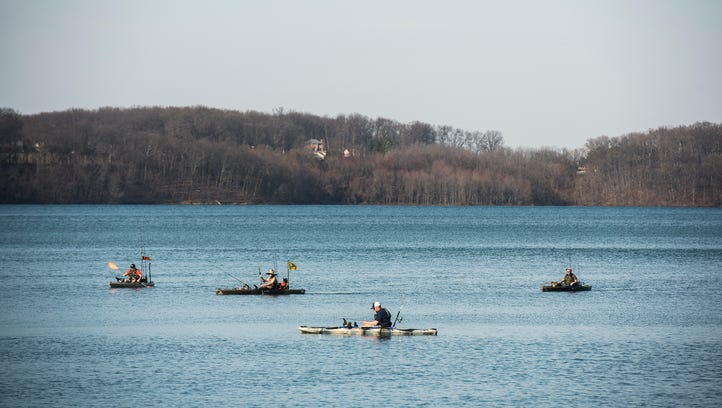 Kayakers fish on Lake Marburg on Wednesday March 9,