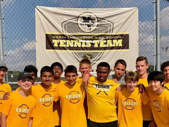 The members of the North Farmington tennis team are