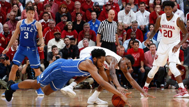 Duke center Marques Bolden scrambles for a loose ball against Indiana guard Aljami Durham during the second half at Assembly Hall in Bloomington, Ind.