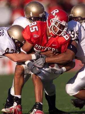 A 2003 NFL Draft pick by the Philadelphia Eagles, L.J. Smith went back to Rutgers and graduated in 2016.