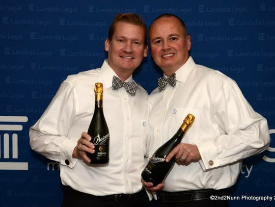 Thom (left) and Tim DeWitt, were married in Canada