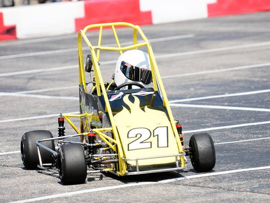 Ben Burchard races in his No. 21 car, one of his first midget quarter cars.