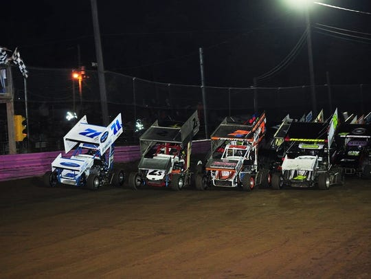 Drivers run a four-wide parade lap during the National