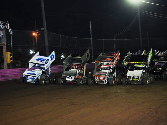 Drivers run a four-wide parade lap during the National Open for sprints at Linda's Speedway.