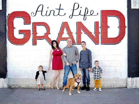 The Capitano family as photographed in downtown Phoenix: Kingsli (from left), Megan, Anthony, Ashton and Lincoln.