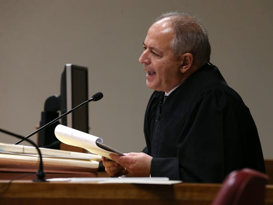 Judge James Piampiano, begins to read the law behind