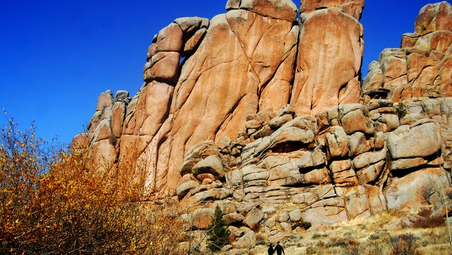 A pair of hikers walk the popular Turtle Rock Trail in Vedauwoo Recreation Area.