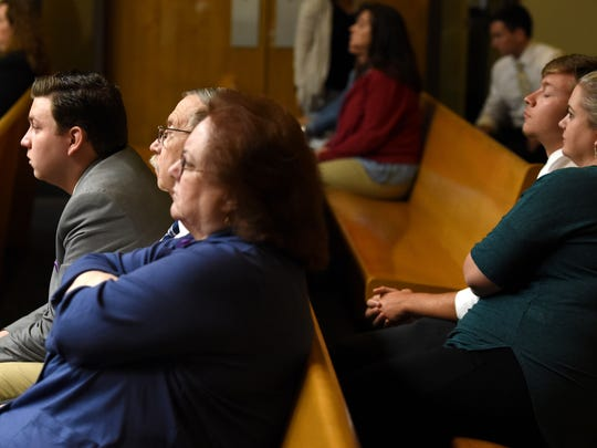 Jessica Cox's stepsons Justin McIntosh, left, and Austin McIntosh, right, listen as their stepmother is sentenced by Judge Bob McGhee to 24 years in prison Friday, May 19, 2017. Cox, 40, was convicted in March of 23 counts of aggravated child abuse and one count of reckless endangerment.