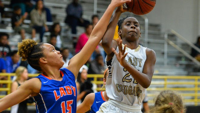 Northwest Rankin's Maya Jones has her shot altered by Madison Central's Mimi Bishop during the Region 3-6A consolation game. MC won 35-34.